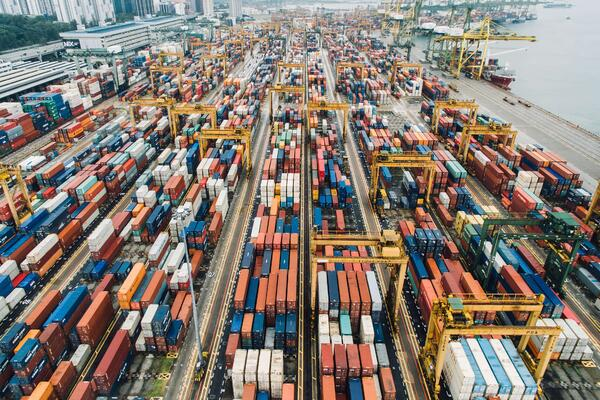 Digital transformation in logistics_ environmental sustainability_ containers_port_aerial view