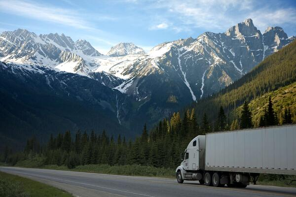 Digital transformation in logistics_ environmental sustainability_ truck_ mountains ladnscape
