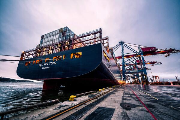 Digital transformation in logistics_environmental sustainability_cargo ship_containers_sailing