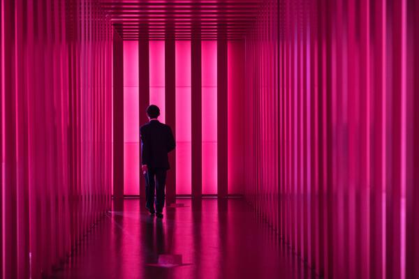 business man going through led corridor as a metaphor of process innovation
